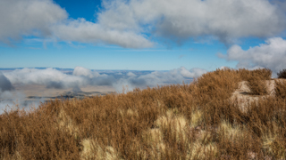 Image of Socorro Valley, looking down from M Mountain, with clouds in the sky