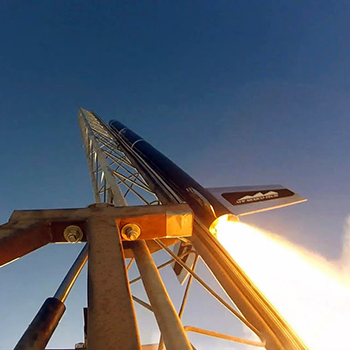Image of rocket launching from pad